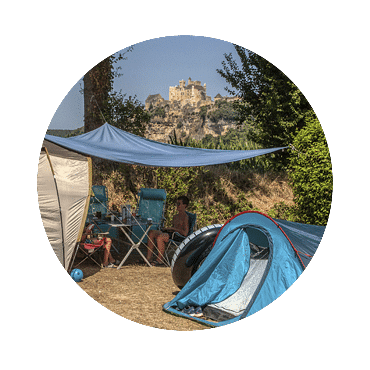 Shaded site with mobile home caravan and view on the castle